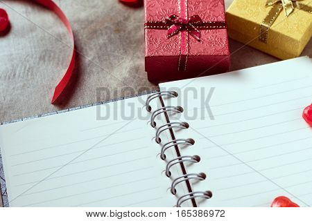 Valentines Day Background. Valentine Hearts With Open Blank Notebook On Dark Wooden Background. Writ