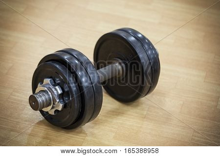 Heavy dumbbell on floor of the gym