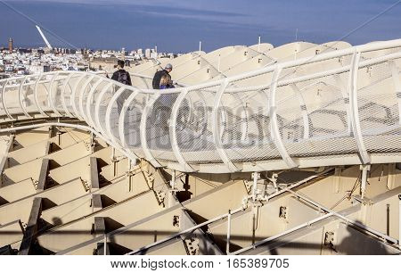 Seville Spain - January 2 2017: Roof footbridge for pedestrians at Metropol Parasol with photographer shadow