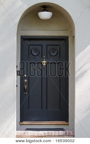 Black Front Door on tan stucco house