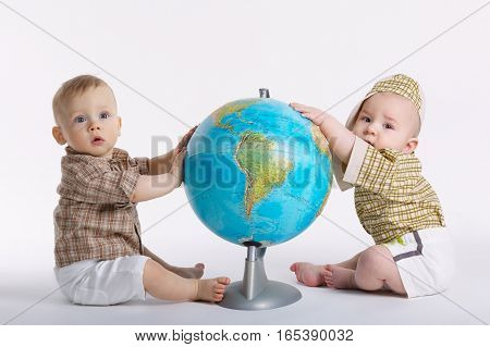 photo of little funny boy with globe on white