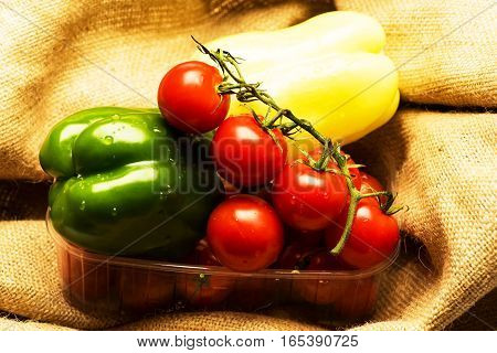 Red Cherry Tomatoes And Peppers
