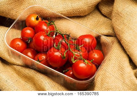 Red Cherry Tomatoes On Sacking