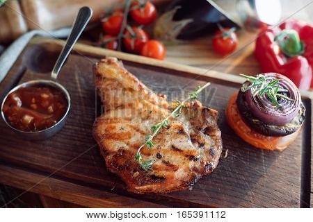 brisket with sauce on a wooden board over wooden vintage backround