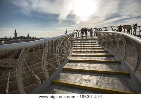 Seville Spain - January 2 2017: Visitors on the roof footbridge at Metropol Parasol at sunset