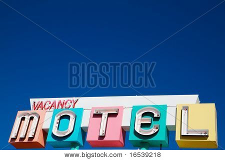 Multi-colored neon Motel and vacany sign in a 1950s style