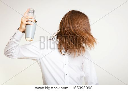 Alcohol liquor party happiness relax passion concept. Long haired barman shaking head. Young male bartender waves hairs shakes glass.