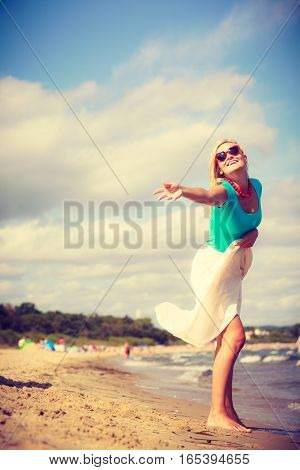 Attractive Woman On The Beach.