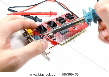 Soldering the diode on the DVR motherboard with a soldering iron on a white background