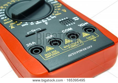 Case digital multimeter closeup on white background