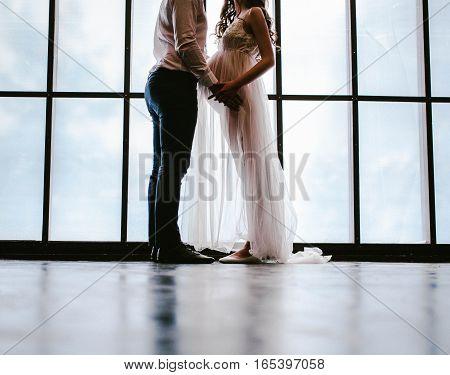 A man hugs a pregnant girl. Moscow city