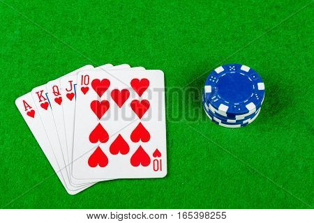 Royal flush poker had with betting chips