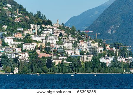 Lake of Lugano with the hill and the city on background