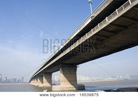 The highway bridge with a blue sky background.