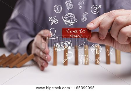 Business, Technology, Internet And Network Concept. Young Businessman Shows The Word: Time To Share