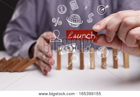 Business, Technology, Internet And Network Concept. Young Businessman Shows The Word: Launch