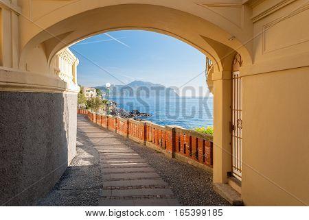 Glimpse of a route in Bogliasco near Genoa; the promontory of Portofino in the background