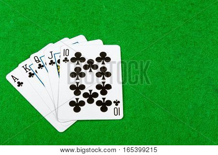 Royal flush poker hand on  a card table