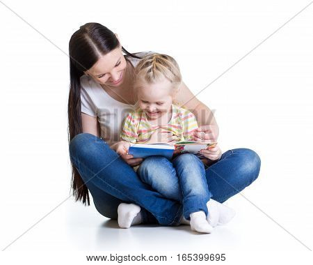 happy mother reads a book to baby girl isolated