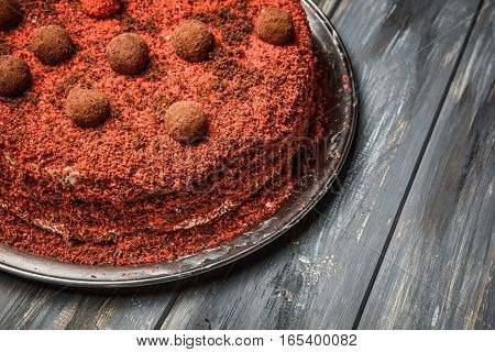 Piece of homemade berry cake on the wood background.