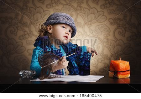 photo of little beautiful vintage writer girl