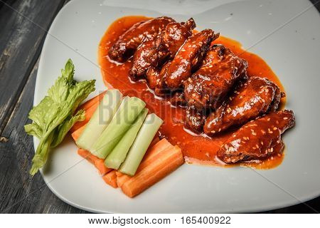 buffalo chicken wings with blue cheese dip.
