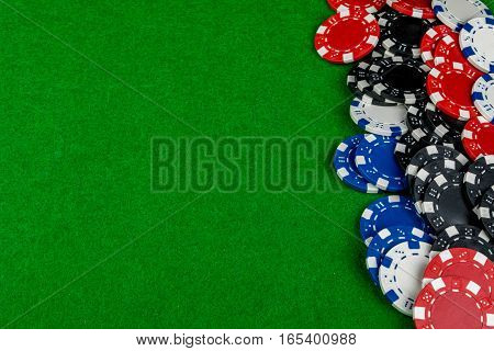 Betting chips laying on a card table covering a third