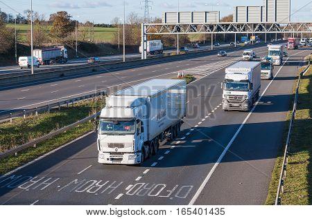 London, UK - November 2016: Traffic on the British M1 motorway and junction to motorway M25