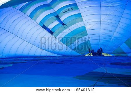 OLDENZAAL NETHERLANDS - APRIL 6 2016: Flight crew is filling a hot air balloon with air