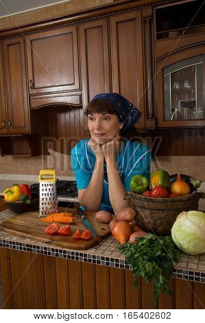 woman among the vegetables in the kitchen