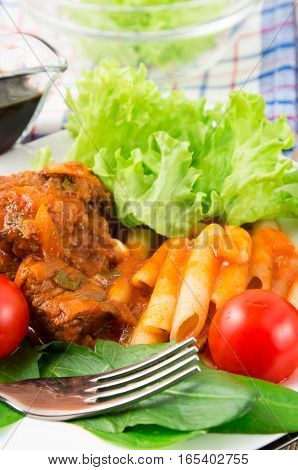 Dish Of Beef Stew With Pasta Penne, Cherry Tomatoes And Fresh Herbs