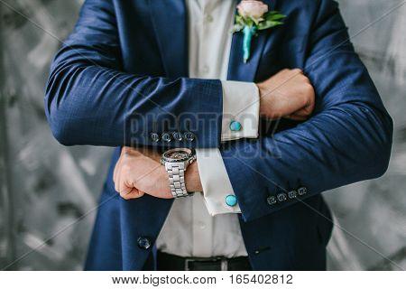 Groom cufflinks on shirt. Wedding formal moment