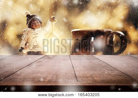 Empty Tabletop With Blurry Little Boy Christmas Toy Decoration With Snow Stardust Magical Glitter Me