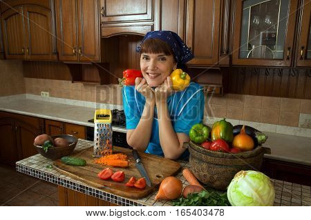 woman holds in hands sweet bell pepper