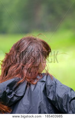 girl in raincoat on green background. it's going to rain in weather forecast