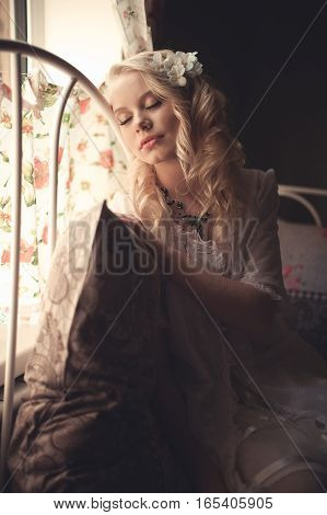 Young Beautiful Blonde In The Bed At Morning Time Near Window Un