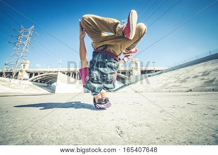 bbyos doing some stunts - Street artist breakdancing outdoors