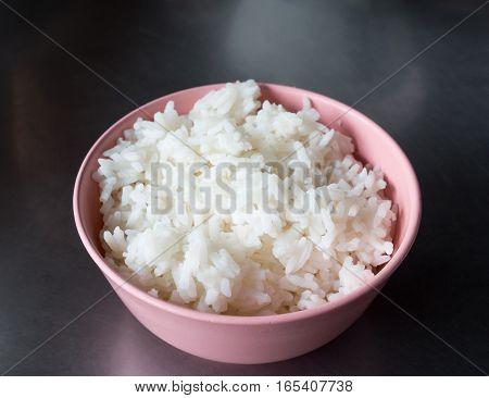 Jasmine rice in the plastic bowl for serve in the Thai restaurant.