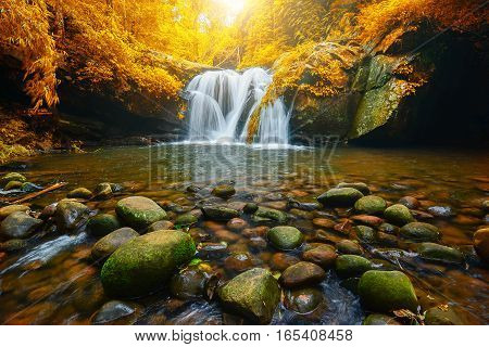 Landscape photo Phu Soi Dao Waterfall with yellow leaves trees beautiful waterfall in rainforest at Uttaradit province Thailand