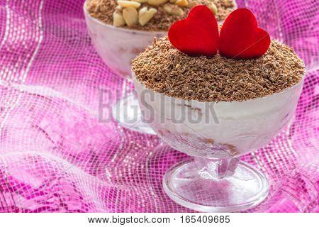 Dessert tiramisu (cheese dessert) in fancy bowls for Valentine's day.
