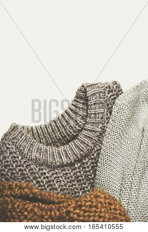 Tinted Image Three Warm Sweaters On Lighte Background, Vertical