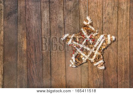 Handmade star for celebration on the background of wooden boards