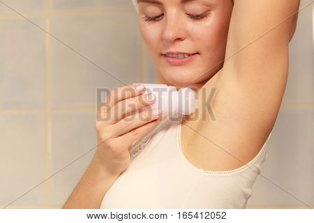 Woman Applying Stick Deodorant In Armpit