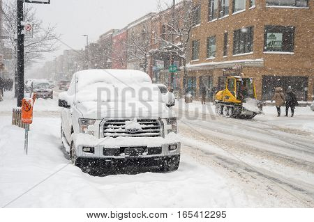 Montreal QC Canada - 29 december 2016: Cars covered with snow on Mont-Royal Avenue.