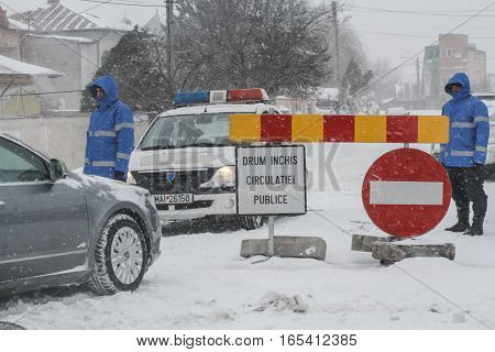 Afumati Romania January 26 2014: Police closed a road in Afumati because of the severe weather conditions.