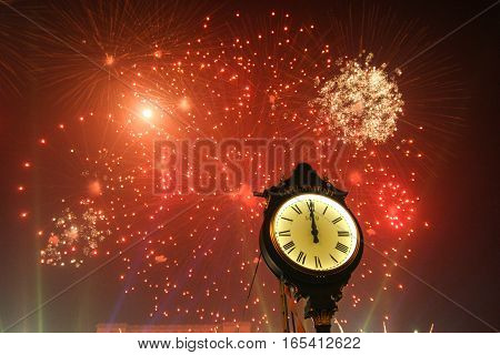 Bucharest Romania January 1 2012: Fireworks and clock in celebrating the New Year.
