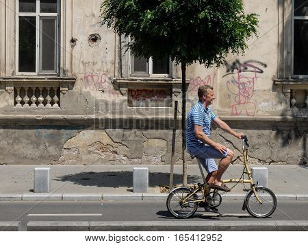 Bucharest Romania July 24 2016: A man is riding a bicycle on a designed track for bicycles in the center of Bucharest.