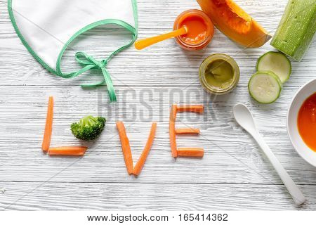 baby vegetable purees on wooden background top view.