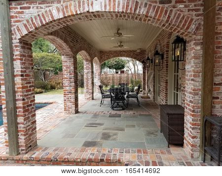 Outdoor Patio of Stone and Brick Near Pool