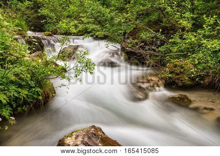 Long exposure picture of Avisio stream in Val di Fassa Trentino Italy